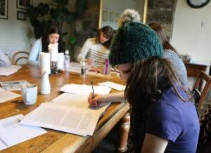 Young writers at work at First Story's Lumb Bank residential.